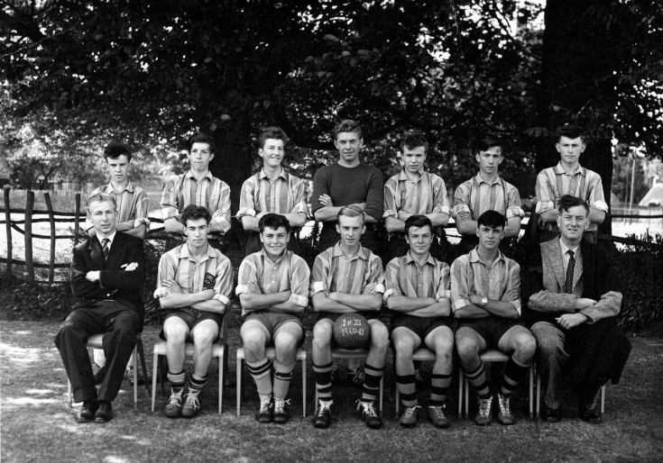1960-61 First XI Football Team (Back Row) Robert Gardner, John Currill, Laurence Taylor, Robert Cholerton, Robin Print, Rodney Gillett, David Webb (Front Row) Mr P Moore, Roger Mansell, Michael Garaway, Colin Burrows, Andrew Chisman, Willie Wiechec, Mr A. L. Jones