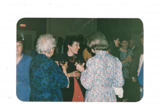 Tess talking to Miss David at the 550th anniversary party.